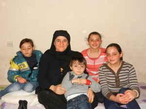Sister Hatune Dogan with poor Christian family in Turkey