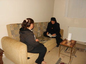 Sister Hatune Dogan giving money to poor Christian women