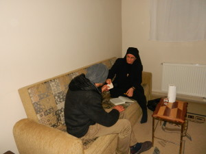 Sister Hatune Dogan giving money to poor Christian man
