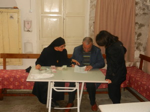 Sister Hatune Dogan, organizing the giving of money to poor Christians